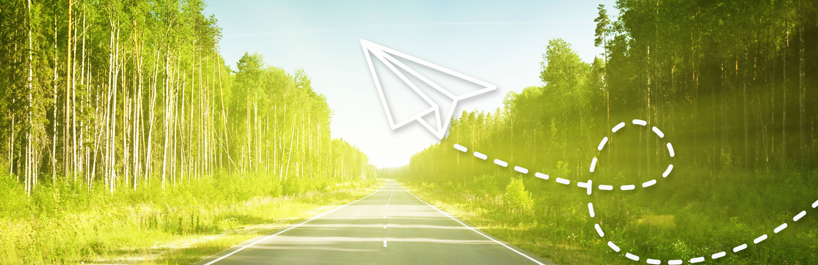 Road with a paper airplane flying across